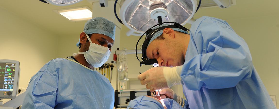Two members of our surgical team in an operating theatre