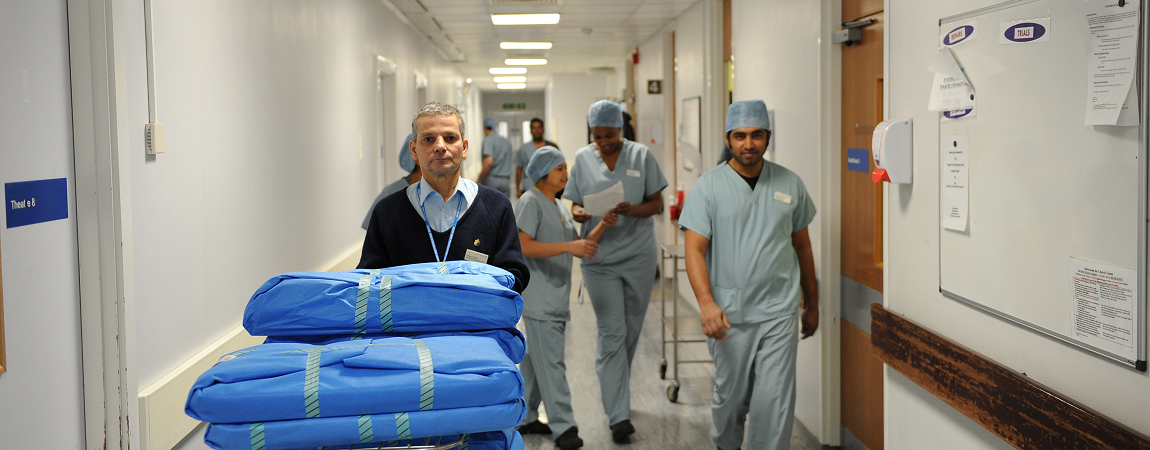 Porter with clinical staff in corridor