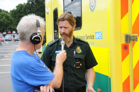 At the Community Day - Radio Wey interviewing a member of the ambulance team